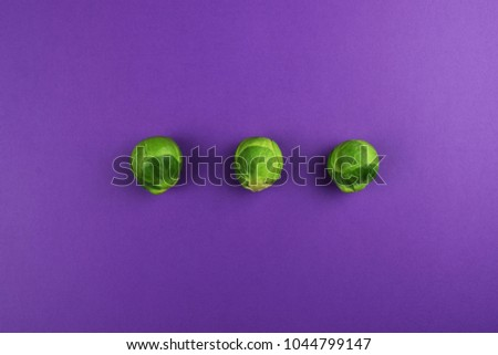 Green brussel sprouts isolated on white purple background and blue background, single, sorted, align, arranged in a triangle, with modern and fashion style