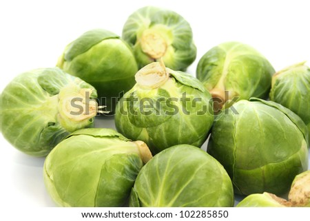 Green brussels sprouts on white background.