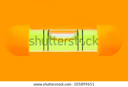 Green bubble level in orange background