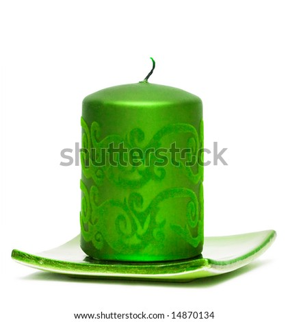 green burning candle on white background
