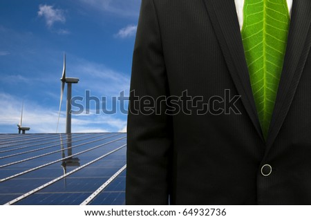 Green Business and eco energy.businessman with leaf tie and solar panel and windmill