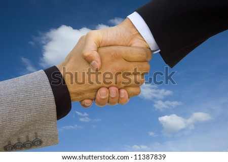 Green business team work! Handshake to seal the agreement
