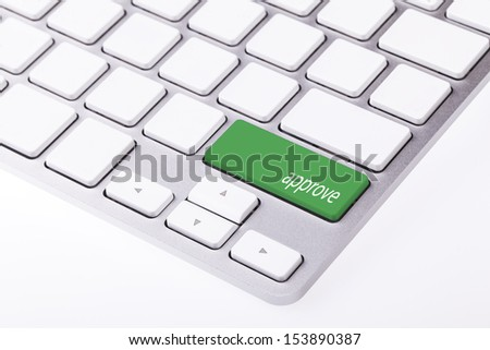 Green button with word 'approve' on keyboard