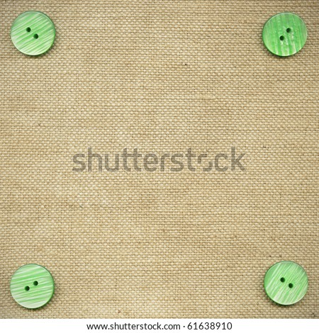 Green buttons on the beige fabric