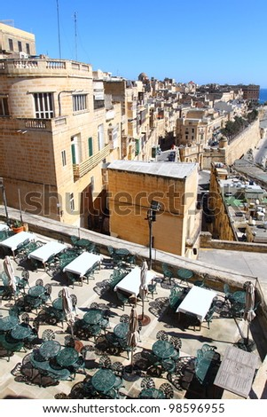 Green cafe chairs in the harbour of Valletta, Malta