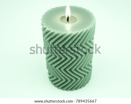 Green candle with flame and zigzag pattern #789435667