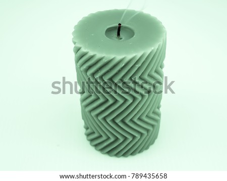 Green candle with small smoke and zigzag pattern #789435658
