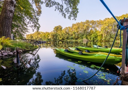 Green Canoe Berthed in Wilanow River