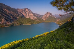 Green Canyon - one of the main attractions of Turkey. Natural beauty of Turkey. Mountains, green pines, turquoise lake. Mountain landscape with forest, trees. Beautiful mountain lake backround. Rocks