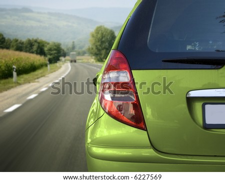 Green car on the road