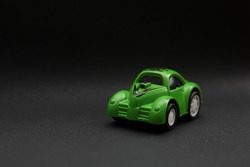 Green car toy with blur black background