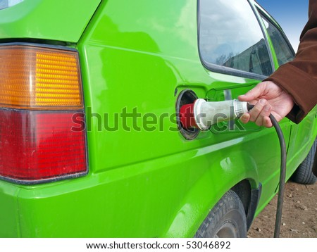 Green car using electricity as the fuel