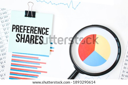 Green card on the white notepad and magnifier on the financial documentation. Text PREFERENCE SHARES. Business concept Zdjęcia stock ©