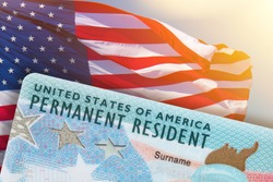 Green Card US Permanent resident card USA. Electronic Diversity Visa Lottery DV-2022 DV Lottery Results. United States of America. American flag on background.