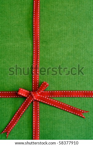 Green card with red bow and ribbon for Christmas