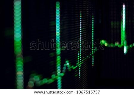 Green cardiogram glowing in the dark