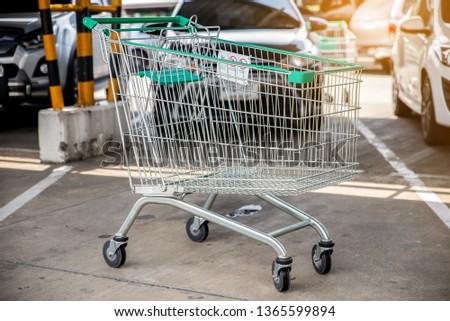 1e15486258e green cart or trolley parking on car park outdoor lighting  1365599894