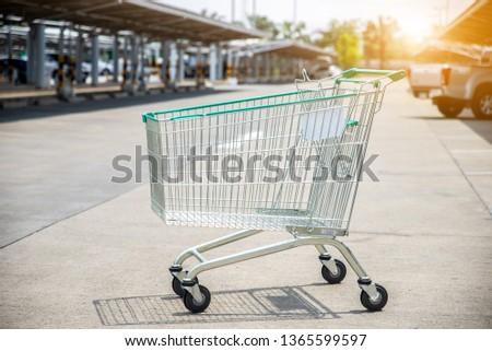 512d9d8ec74 green cart or trolley parking on car park outdoor lighting .selective focus  blurred background