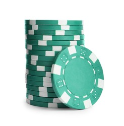 Green casino chips stacked on white background. Poker game