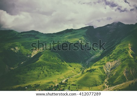 Green caucasus  mountain landscape in Georgia, natural travel vintage hipster vacation background #412077289