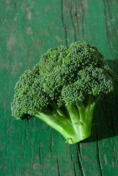 Green cauliflower broccoli inflorescence on bright sunbeam on summer day freshly cut. Garden eco vegetables harvest