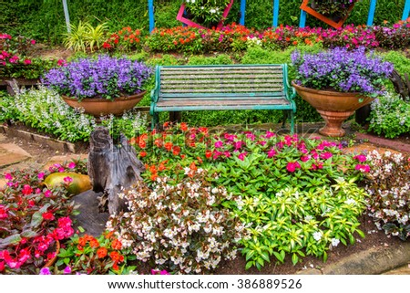 green chair in beautiful colorful garden