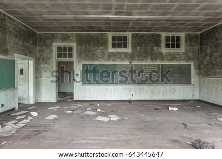 Green chalkboard in an abandoned classroom