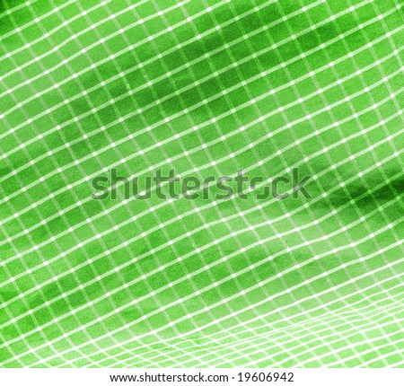 Green checkered picnic textile close up background. More fabrics in my port.