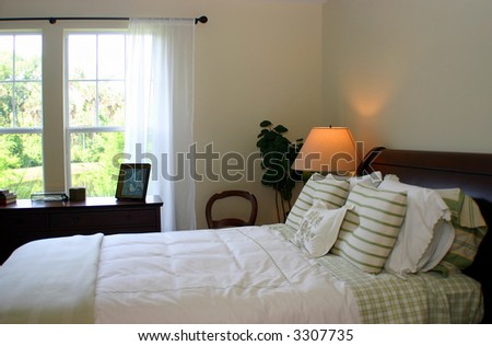 green checks and stripes bedroom