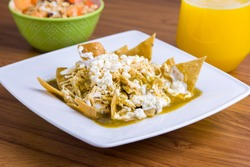 Green chilaquiles with fruit coktail and orange juice