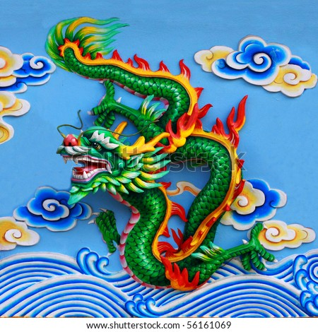 green chinese dragon at the wall of temple, Thailand