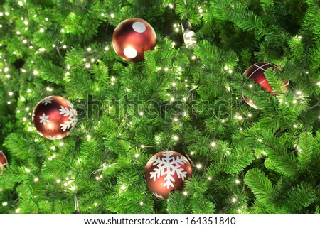 Green Chirstmas tree with Ball and light for winter season.