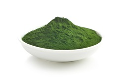 Green chlorella or green barley powder in bowl isolated on white background.