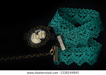 Green choker with girl cameo on a dark background close up #1338144845