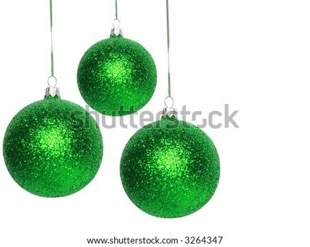 green Christmas balls over white background