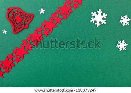 green christmas card with bell and stars