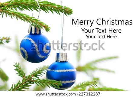 Green Christmas Fir Tree With Two Blue Christmas Balls Whith Silver Decoration On It And Your Text Here, White Background, Merry Christmas
