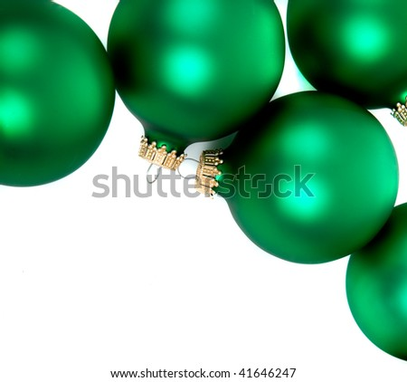 Green Christmas ornaments/bauble on a white background with copy space