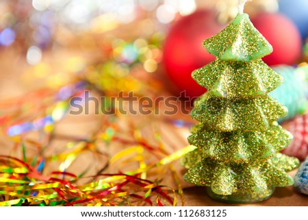Green Christmas Tree candle against lights background