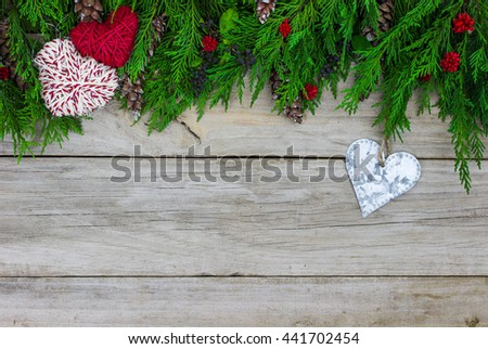 Green Christmas Tree Garland Rope Hearts And Tin Heart Border On Antique Rustic Wood Background