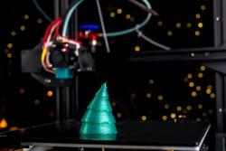 green Christmas tree printed on 3D printer.