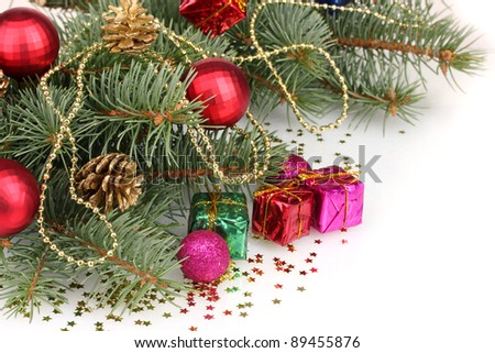 Green Christmas tree with gift, toy and cones isolated on white