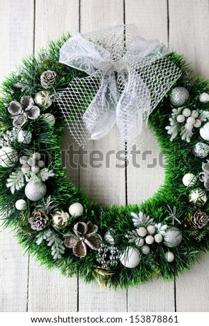 green Christmas wreath on the white door, holiday