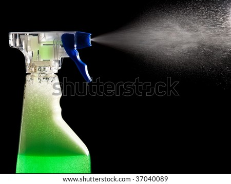 Green cleaning agent being sprayed