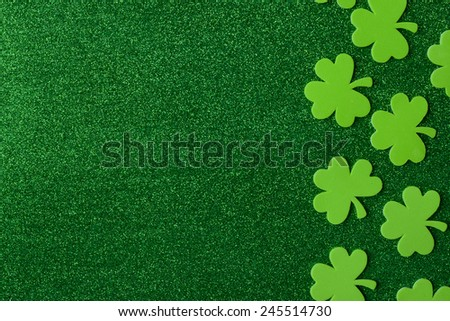 Green Clovers or Shamrocks  on Green Background Background for St. Patrick's Day Holiday