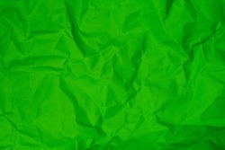 Green clumped paper texture background, carft paper board wrinked and rough material, dark and bright folding clumpy paper