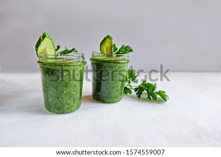 Green cocktail of spinach, lemon, cucumber and parsley on a light background. The concept of healthy nutrition, detox, green, diet, vegan, keto, fit #1574559007