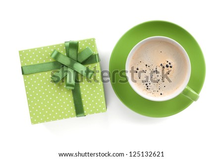 Green coffee cup and gift box with bow. View from above. Isolated on white background