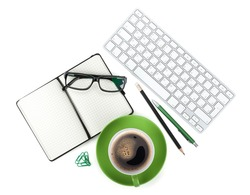 Green coffee cup and office supplies. View from above. Isolated on white background
