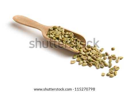 green coffee in wooden scoop on white background